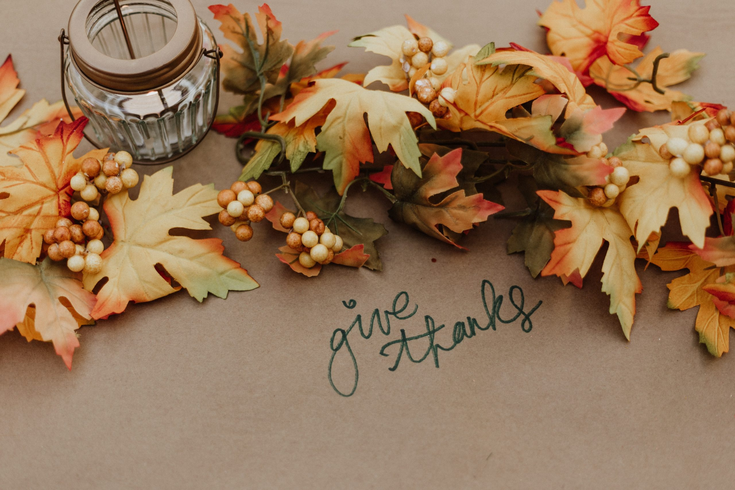 "An image with fall leaves and the words ""give thanks"""